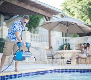 a pool vac being inserted into the pool